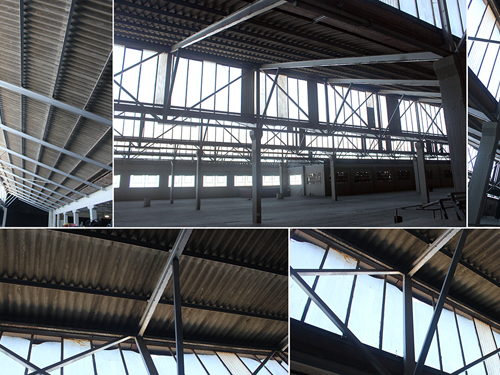 Inside view of current Studio A showing sawtooth steel and asbestos roof structure